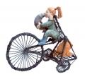 LolaKaplan_Girl_Rides_Tricycle